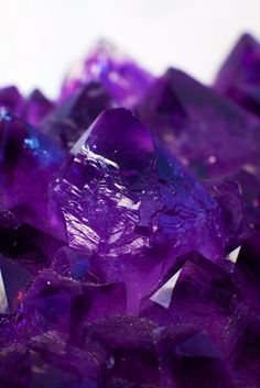 "Amethyst is a violet variety of quartz often used in jewelry. The name comes from the Ancient Greek ἀ a- (""not"") and μέθυστος methustos (""intoxicated""), a reference to the belief that the stone protected its owner from drunkenness. The ancient Greeks and Romans wore amethyst and made drinking vessels of it in the belief that it would prevent intoxication. It is one of several forms of quartz. Amethyst is a semiprecious stone and is the traditional birthstone for February."