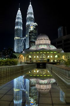 KLCC Mosque, Malaysia:  I feel this image sums up Malaysia perfectly - a confluence of modern technology and ancient beliefs, in a glittering display of wonderful sights to behold, and adventures to experience.