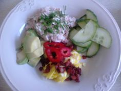 Ham salad, cucumbers, red bell pepper, avocado and some butterscrambled eggs with bacon.