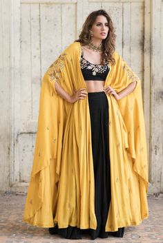 Black Crop Top & Skirt With Cape Jacket. For order whatsapp us on wedding outfits wedding dress wedding dresses lengha lehnga sabyasachi manish malhotra Indian Attire, Indian Wear, Red Indian, Indian India, Indian Designer Outfits, Designer Dresses, Indian Dresses, Indian Outfits, Anarkali