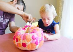 pumpkin decorating idea for toddlers (with links to ideas from this couples' previous years pumpkin decorating with a 5 month old--2010, and 1 year old--2011).  I so love this blog!!  i read it every day....