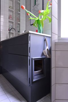 Built in kitty litter box genius! from: Natasha & Rob's Super Smart Small Space — Video House Tour | Apartment Therapy