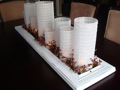 Maybe put paper around jars to create luminaries to go inbetween the pumpkins on the main dessert table