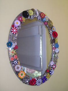 Do it  yourself with retro pins. Saw this in one of the homes I showed.Client didn't love the house...but loved this mirror. This a group of costume jewelry pins hot glued to a mirror frame...too cute!