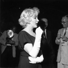"""Marilyn Monroe at the press conference announcing the making of """"Some Like It Hot"""" at the Beverly Hills Hotel, 1958."""