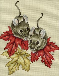 Field mice.  I cross stitched this on vinyl-weave 14 count cross stitch fabric for a 3 ring binder cover.