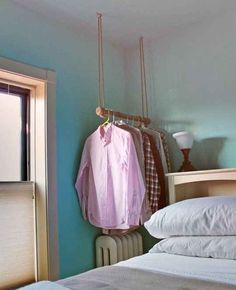 A Ceiling-Hung Garment Rack | 33 Insanely Clever Things Your Small Apartment Needs