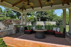 Pavilion and covered patio with sofa lounge and outdoor kitchen overlooking private tennis court