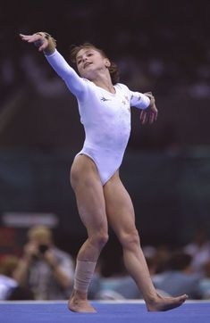"""Dominique Moceanu, the pint-sized youngest member of the Magnificent Seven, delighted the Atlanta audience with her sprightly floor routine set to """"The Devil Went Down to Georgia."""" In the individual floor exercise event, she finished fourth, one place out of a medal."""