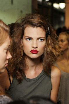 Red lips and  hair cut and style