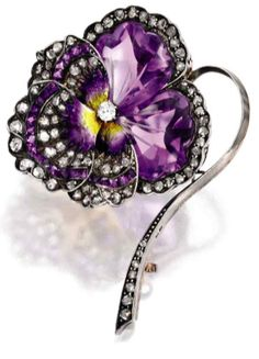 Rose gold, silver, amethyst, diamond and enamel brooch, France. Designed as a pansy, composed of two calibré-cut and engraved amethyst petals, accented by calibré-cut buff-top amethysts and small rose-cut diamonds, centring one old European cut diamond, highlighted with purple and yellow enamel, with French assay and partial maker's marks, circa 1880. #antique #brooch