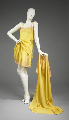 1920-1925 three-piece lingerie/boudoir set. A vivid and interesting color combination; these coordinates would have been quite eye-catching. Of most importance are the drawers, for they are a nice example of the transition from utilitarian drawers to sensual underwear.