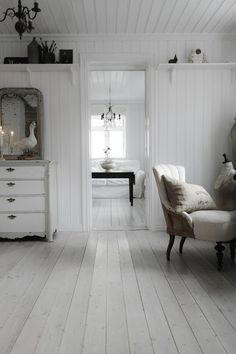 Vintage Interior. just needs a great big rug to sink your toosies in...and a bit more color...but I love it!!!