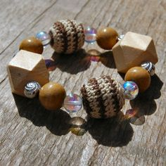 A nice and chunky bracelet strung with glass, wood and crocheted beads on elastic cord.