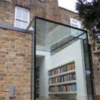 lots of natural reading light: structural glass box becomes the library