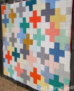 Quilt Paradigm: A Modern Plus Finish :)   A good idea for straight line quilting a plus quilt....