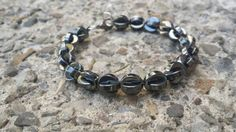 Check out this item in my Etsy shop https://www.etsy.com/listing/207631306/pac-man-style-hematite-bracelet-for-men