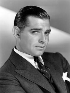 Clark Gable, no mustache. Reminds me of George Clooney or should I say...Clooney reminds me of Gable!