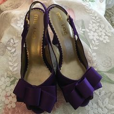 Shoes Beautiful satin purple open toe bow heels! Ready for summer!!! I only have worn there one time ! The wear is from a foot cushion I stuck on them because my feet are a half size down in some shoes. Other than that the outside is almost perfect!!! I can no longer wear heels me too Shoes Heels