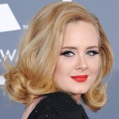 Pin for Later: Endless Gorgeous Celebrity Wedding Hair Ideas Wedding Hairstyles: All Down Love the look of the '50s? Adele's soft shoulder-length curls at the 2012 Grammys complemented her vintage makeup look beautifully.