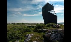 Completed in 2011 in Bay Roberts, Canada. Images by Bent René Synnevåg. The Tower Studio is dramatically situated on a stretch of rocky coastline in Shoal Bay, Fogo Island, Newfoundland. The studio's sculptural silhouette.