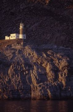 Cape Papas Lighthouse in Ikaria island in Greece Lighthouse Lighting, Places To Visit, Places To Travel, Samos, Greece Islands, Greece Travel, Architecture, Nature, Beautiful Places