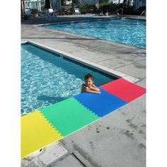The concrete edges of a can be rough on swimsuits and dangerous for children. Here's an example of using NORSK™ foam tile to help make your pool kid ( and swimsuit ) friendly. It really takes the edge off ; Foam Flooring, Tile Flooring, Garage Floor Tiles, Learning Environments, Fun Learning, Swimming Pools, Outdoor Blanket, Backyard, Playrooms