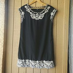 """Lace Accent Tunic Black with light beige stitched lace detail at neck, sleeves, and collar. Approx 18"""" flat across bust, 20"""" flat across hem so slightly a-line. No real stretch but not stiff. Polyester with cotton thread. Drop sleeve but not quite cap sleeve. 32"""" total length. Short dress or tunic with leggings. Side seam pockets at hips. Forever 21 Tops Tunics"""