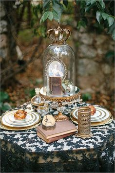 This reminds me of the Black, ivory and gold china I inherited from my grant aunt. Never thought to use it with black lace as the table cloth. Gorgeous and classy.