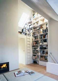 My ideal home is your daily source of interior design, architecture, home ideas and interior inspirations. Attic Renovation, Attic Remodel, Living Room Remodel, Living Rooms, Floor To Ceiling Bookshelves, Bookshelf Wall, Wall Shelving, Reading Loft, Reading Nooks