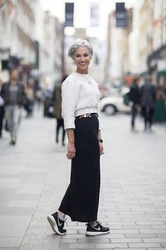 """Charlotte Fotheringham, stylist """"I'm wearing a White Pepper top with a Topshop skirt, a charity shop belt and Nike trainers."""" (Not totally sold on the cropped-ish top and long skirt for me to wear, but I keep liking it more and more on others. By the time I come around fully I'm sure it'll be looong over.)"""