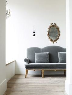 This regal grey velvet works so beautifully with the wood and antique gold mirror.