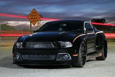 Custom lowered and bodied Black Mustang by RRTP Customs