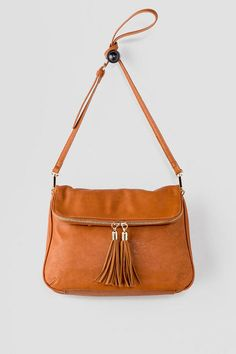 """The Berkley Foldover Crossbody is your new go-to bag! Smooth leather is accented by a golden zipper & coordinating tassels. Finished with a zipper closure, inside pockets & an optional crossbody strap. Wear with a basic blouse, skinny jeans & ankle boots for aeasy daytime look!<br /> <br /> - 13"""" length x 9"""" height x 2"""" width<br /> - 23"""" optional shoulder strap drop<br /> - Imported"""
