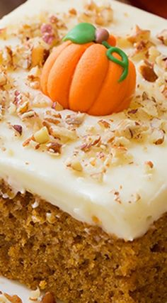 Pumpkin Sheet Cake with Cream Cheese Frosting ~ Tastes deliciously divine... It's the perfect thing to make to feed a group of people during the fall season and you'll love how easy it is to prepare and frost!