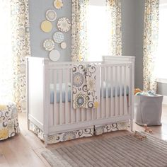 We love a #babyblue #nursery with #white & #yellow accents! #blue #neutral #carouselbedding