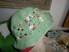 This is a Granny style crochet hat. Made with 6 granny squares sewn together with the brim and crown added on separate . It will make a great beach hat as well as everyday wear if you so choose. It is light and comfortable to wear and will fit the average size head.Can be made in any color and will be able to ship within 1 to 2 days.Machine wash, medium setting , dry mediumComes from a smoke free, pet free home