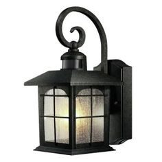 This wall lantern is gorgeous! Looks like it should be hanging in Frodo's house in Lord of the Rings!