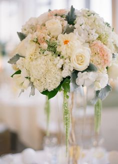 Tall, white & green centerpieces // // Photo: Esther Sun Photography // Coordination: live.love.create events // TheKnot.com