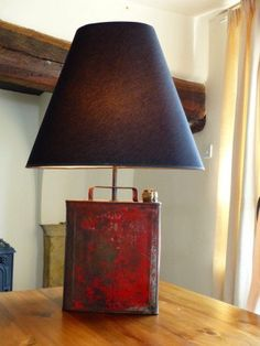 Upcylced Table Lamp - Handmade on season two of the Money for Nothing BBC1 show. Guy has recycled this old retro red 1950's fuel can and converted it into a styish man cave table lamp. The aged paintwork and industrial feel make this a must have piece for any man cave. Soon to be seen on BBC1. Please note the original one from the show has been sold and listing is for commission order, they are Practically identical.