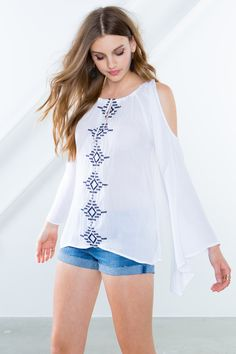 BOUTIQUE FIVE A crepe woven blouse, featuring an embroidered front and a keyhole neck with a self-tie. Cold shoulders. Long sleeves. Spaghetti straps. Finished trapeze hem. $29.90