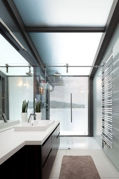 Contemporary Bathroom In White White Sink And Wooden Vanity Bathroom Brown Rug Modern Railing Towels White Tile Floors Glass Showers In White: Fascinating Elegant Modern Home Designs With Dazzling Lake View
