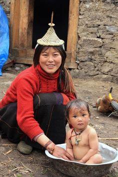 iseo58:  Bhutan - Mother washing baby in tin tub.