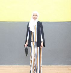 The beautiful @hasnahijabstyle wearing the Tuxedo Cape Blazer by Store WF. 15 % OFF with code HasnaB on Store WF collection only on Haute Elan. Shop now via link in bio.