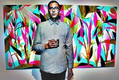 Artist Eddie Perrote in front of his painting for Reserva de la Familia at Supermarket 393