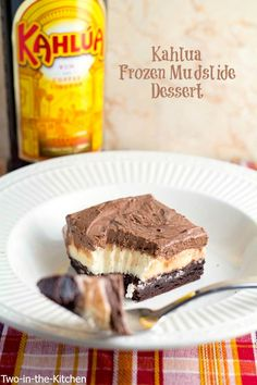 Frozen Kahlua Mudslide Dessert | Two in the Kitchen. An ice cream dessert with a brownie base and Kahlua frosting.