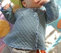 Une veste bébé matelassée