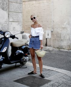 New Look Denim Cut Off Mini Skirt Teamed With Gucci Princetown Fur-Lined Leather Slippers And An Off The Shoulder White Top And A Basket Bag Street Style 2017 Summer Tumblr