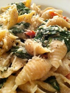 Spinach & Sun Dried Tomatoes in Creamy Goat Cheese Pasta  EVOO  Garlic  Fresh Spinach  Sun Dried Tomatoes  Light Sour Cream  Goat Cheese aka Chevre  Pasta- whatever you like or have around- use whole wheat as a way to up the fiber factor!  S+P  Parmesan+Romano+Asiago Cheese blend