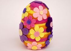 Yarn wrapped Easter egg with felt flowers